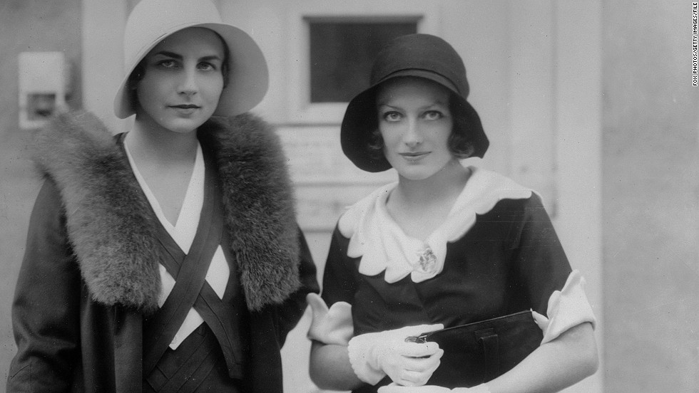 Lenglen's crown as the queen of women's tennis was taken by American Helen Wills Moody, pictured left  with Hollywood actress Joan Crawford.