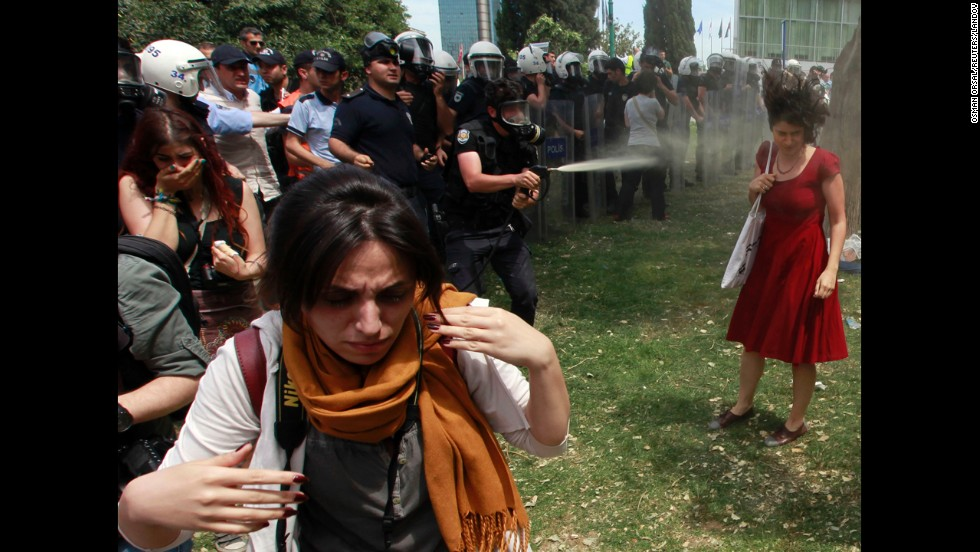 A Turkish riot policeman uses tear gas in Taksim Square on May 28.