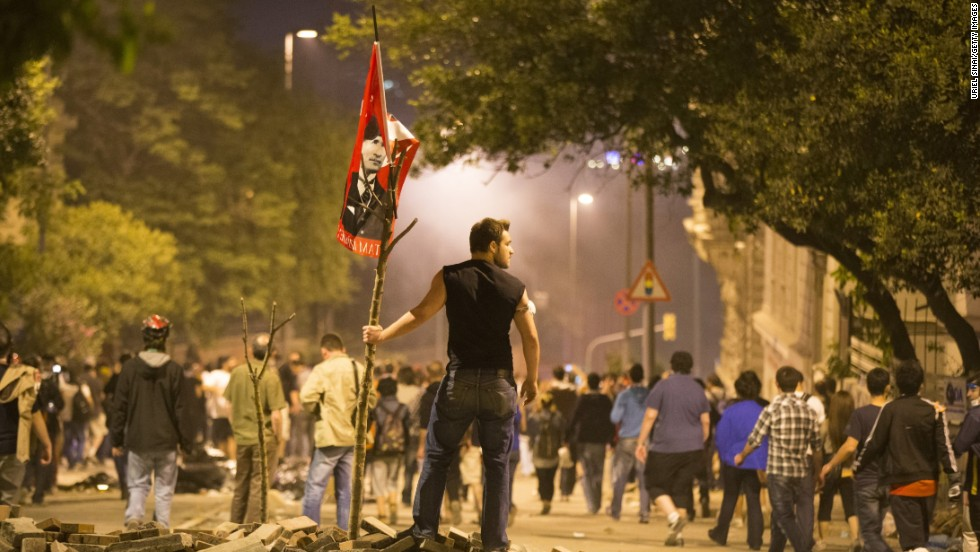 A protester looks on during clashes with Turkish police outside of Prime Minister Recep Tayyip Erdogan's office, near Taksim Square in Istanbul on Tuesday, June 4.