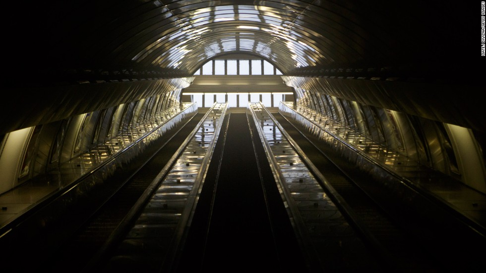 Subway escalators stand empty in a train station in Prague on Sunday, June 2.