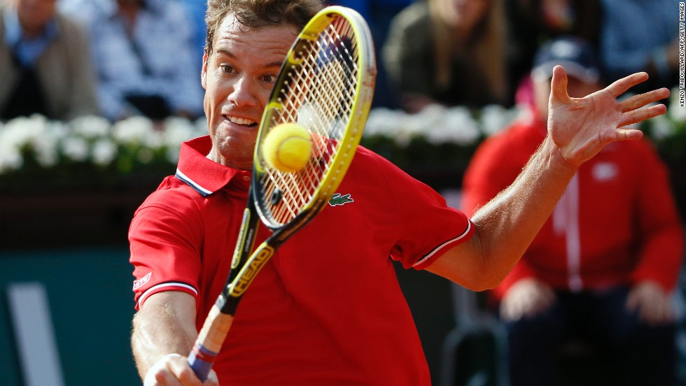 Richard Gasquet of France hits a return to Switzerland's Stanislas Wawrinka during a match on Monday, June 3.