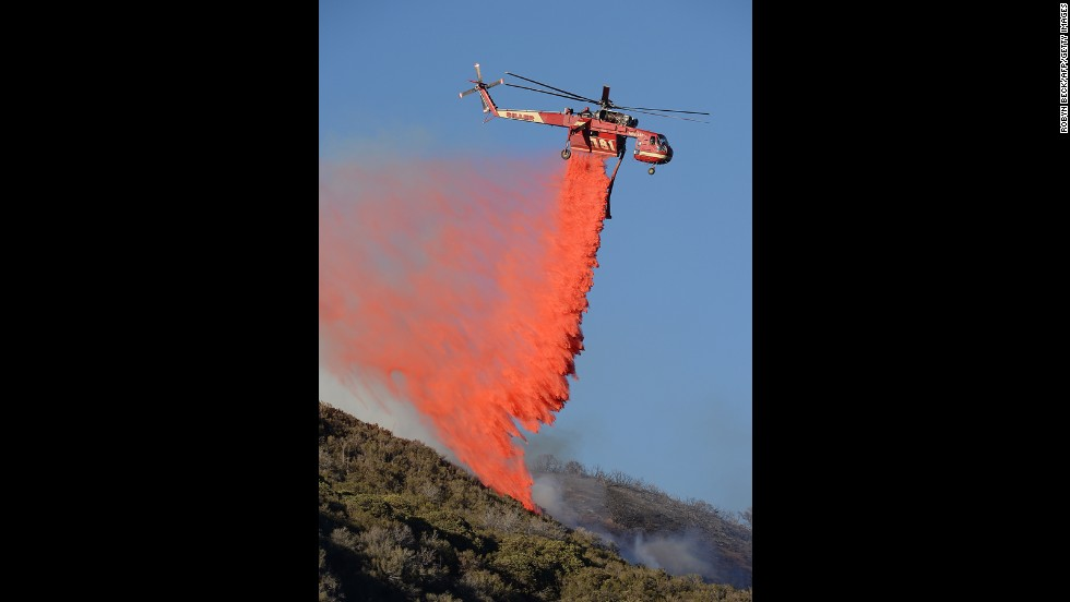 A firefighting helicopter drops fire retardant on a flareup on June 3.