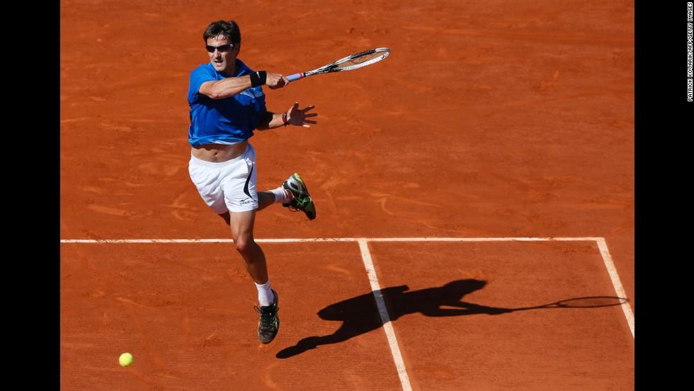 Spain's Tommy Robredo returns to Spain's David Ferrer on June 4. Ferrer defeated Robredo 6-2, 6-1, 6-1.