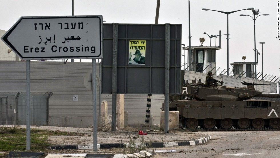 An Israeli army tank is seen along the Erez crossing passage along the southern Israeli border with the Palestinian Gaza Strip in November 2012. Sarsak was arrested at the crossing in 2009. <br />