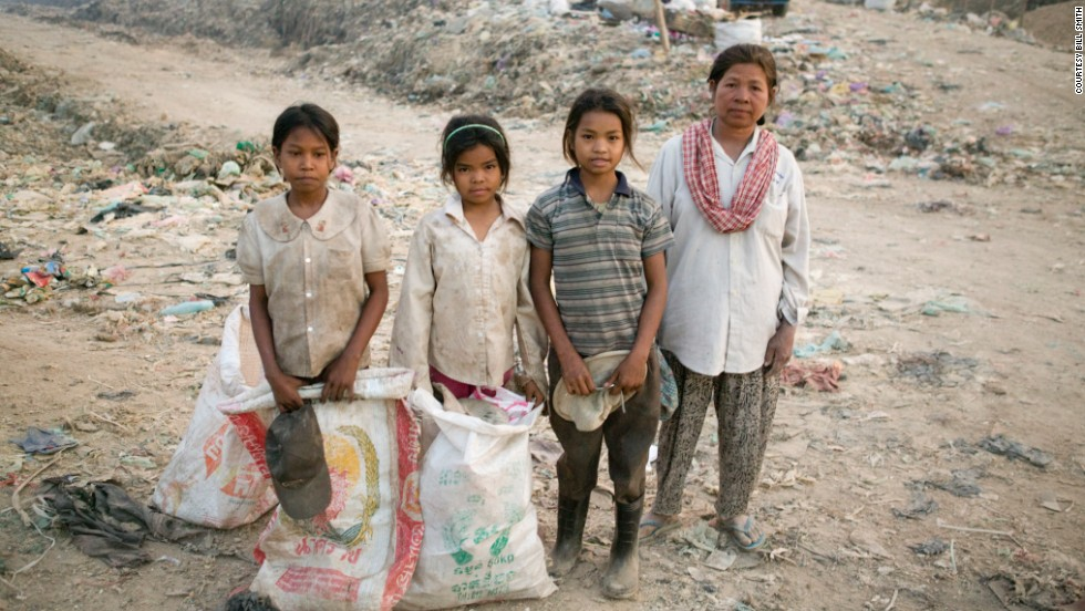 Sreyna stands next to her mother and two other girls. The Smiths made a deal with the girls' mother to pay her what her daughters would make at the dump in exchange for sending the girls to school.