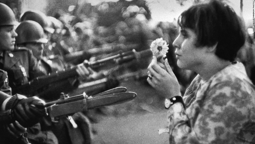 Jan Rose Kasmir stands in front of National Guard members outside the Pentagon during an anti-Vietnam War march on October 21, 1967.