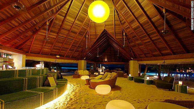 This Maldives bar is so chilled out they couldn't even be bothered putting down a floor.