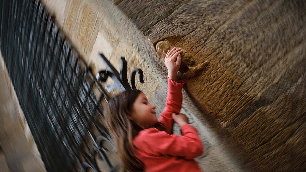 Stopping by Dijon: Rubbing the owl at Notre Dame church is said to bring good luck.