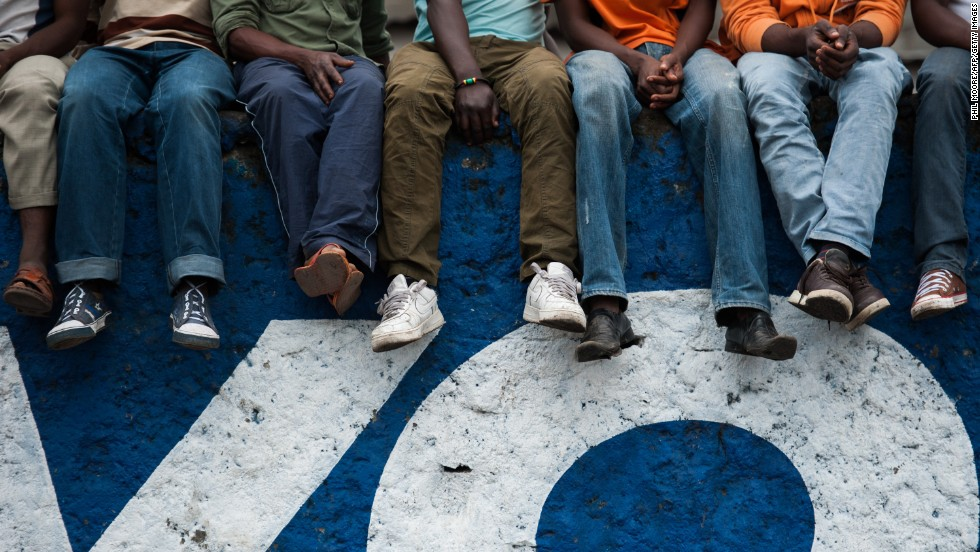 Residents sit on a wall at Volcanoes Stadium in Goma.