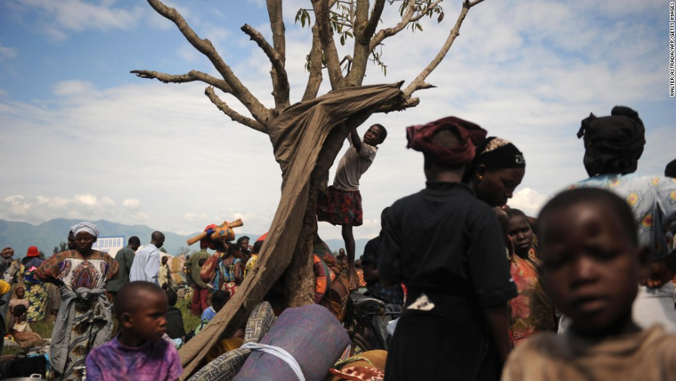A girl climbs a tree at a displacement camp set up in the North Kivu town of Kiwanja. The Democratic Republic of Congo has seen more than its share of violence over the decades. Civil wars have left millions dead across the country and displaced entire generations.