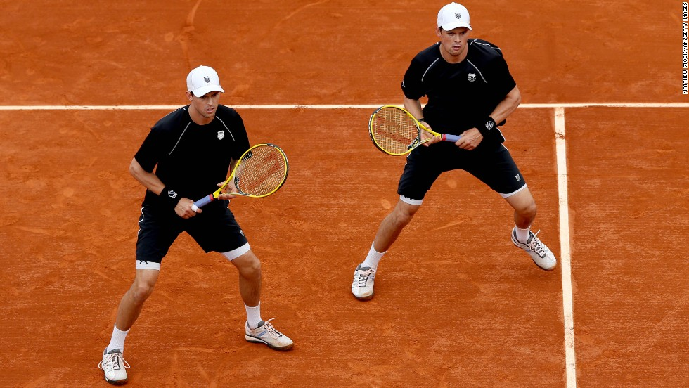 Brothers Mike, left, and Bob Bryan of the United States wait for a return from Alexander Peya of Austria and Bruno Soares of Brazil on June 6.