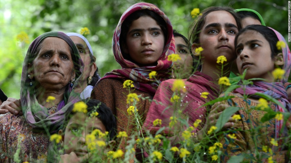 JUNE 6 - KASHMIR, INDIA: Muslim villagers watch the funeral of Altaf Baba, the divisional commander of Jaish-e-Mohammad (The Army of Muhammad), a Kashmir-based Islamic militant group, at Algar-Kandi in Pulwama district, south of Srinagar, on June 6, 2013. Altaf Baba was killed in a gunfight on June 5.