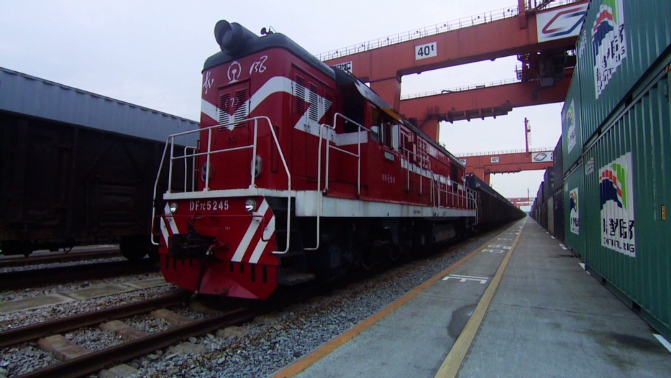 "Bustling freight trains like this 41-carriage vehicle are a common site along the Chongqing to Duisburg rail route -- a modern ""Silk Road"" carrying goods from Asia to Europe and back again."