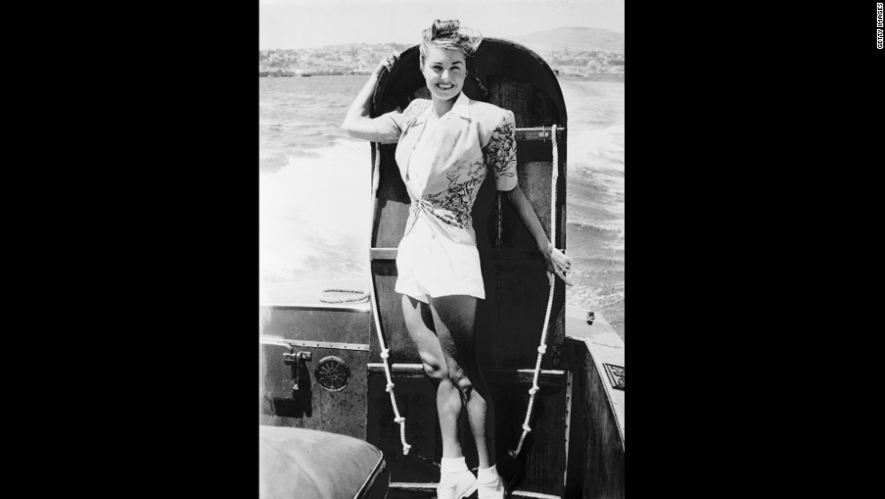 "Williams poses with a ironing board before competing in the ""Ironing board derby"" between Catalina Island and the California coast on August 25, 1947."
