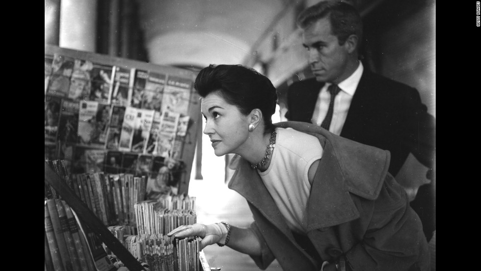 Williams and Argentine actor Fernando Lamas, whom she would later marry, walk through the Plaza Mayor in Madrid in 1961.
