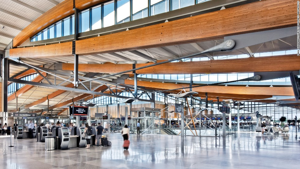 The design of Terminal 2 makes use of wooden trusses, glass and natural light. The rolling roofs are inspired by North Carolina's Piedmont hills.