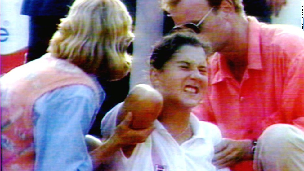 Seles defended all three of her grand slam titles in 1992, and lost in the final at Wimbledon. She then won the  Australian Open for the third time in a row, but the defining moment of her career arrived at the 1993 Hamburg Masters, when a man later identified as an obsessive fan of Graf ran onto the court and stabbed her in the back. Her injuries healed within weeks, but Seles was out of the sport for over two years.