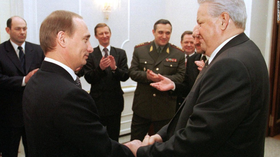Russian President Boris Yeltsin, right, shakes hands with Putin during a farewell ceremony at the Kremlin in Moscow in December 1999. Putin rose quickly through the political ranks, becoming the second democratically elected president of the Russian Federation in 2000.