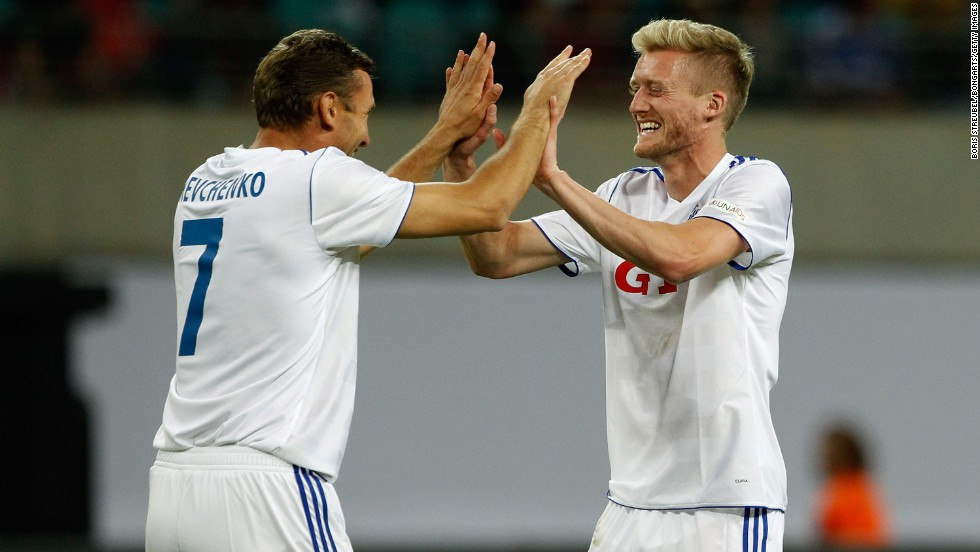 Former Ukraine international Andriy Shevchenko, who played with Ballack at Chelsea, and Bayer Leverkusen's Andre Schurrle, who has been linked with a move to London, celebrate the latter's goal in a match that ended 4-3 to the German XI. Ballack scored a hat-trick.