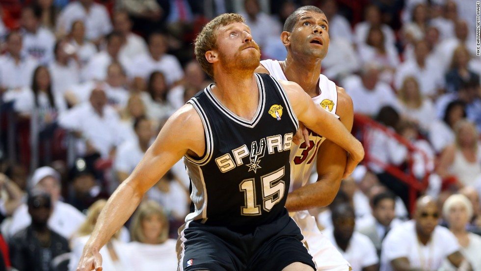 Matt Bonner of San Antonio boxes out Miami's Shane Battier in the second quarter.
