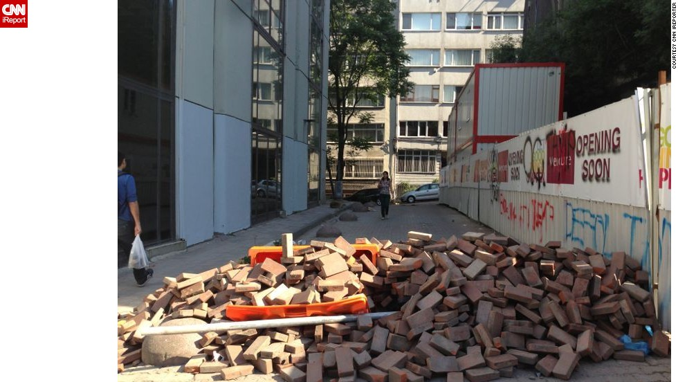 "The same anonymous<a href=""http://ireport.cnn.com/docs/DOC-982570""> iReporter</a> observed this street barricaded by protesters with bricks in Istanbul last Saturday. Turkish Prime Minister Recep Tayyip Erdogan has called for an end to the protests against his government."
