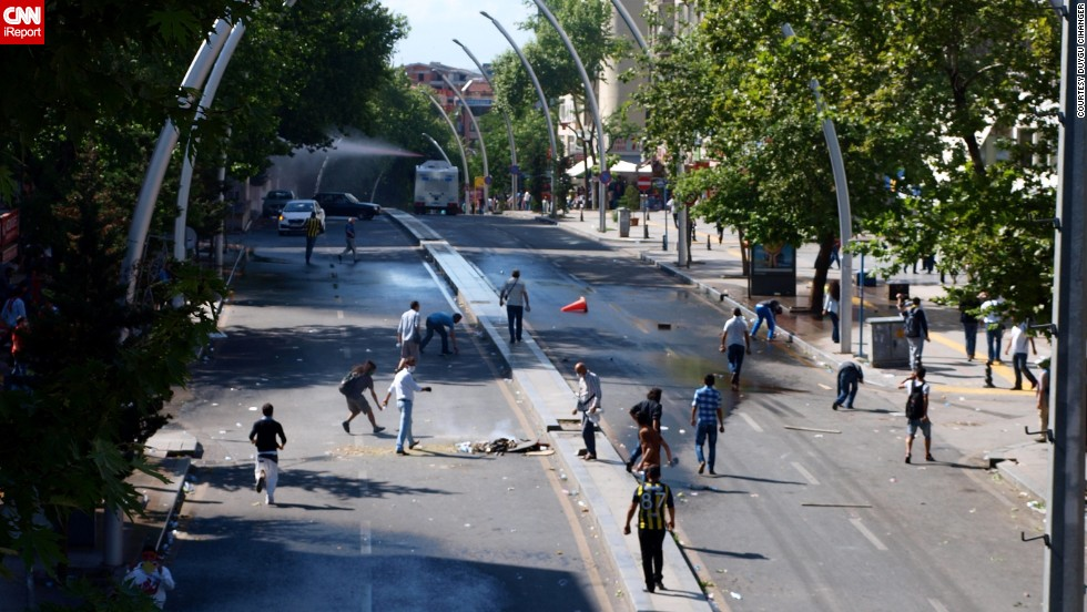 "In the Turkish capital, Ankara, Saturday, iReporter <a href=""http://ireport.cnn.com/docs/DOC-981195"">Duygu Cihanger</a> shot scenes of protesters ahead of what appears to be a police van firing a water cannon."