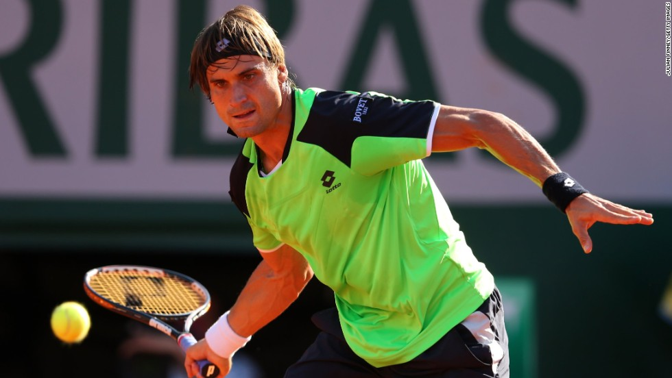 Ferrer plays a forehand to Tsonga on June 7.