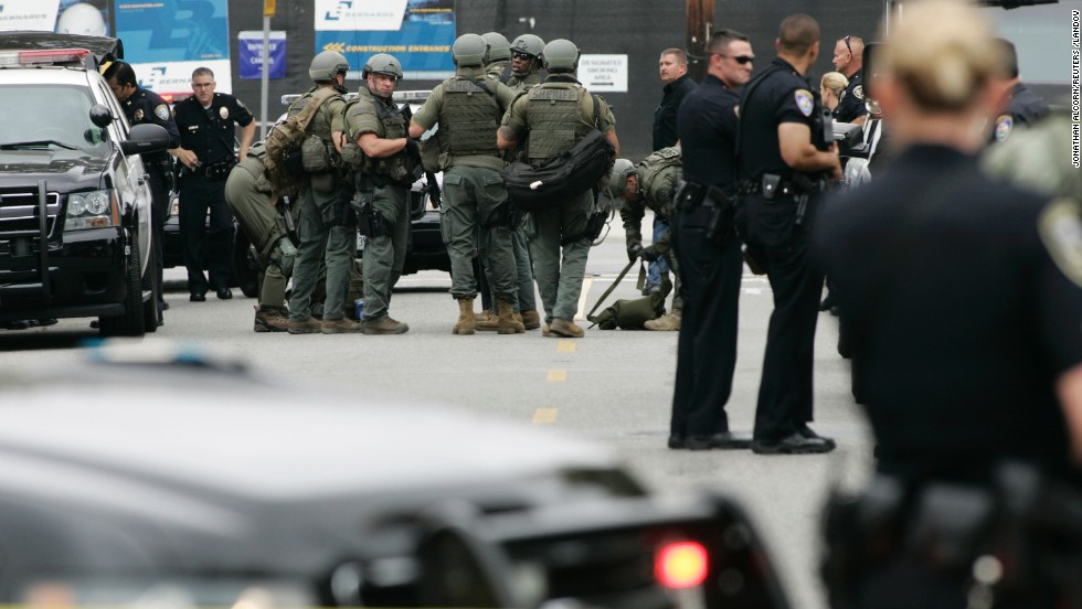 Police gather during the search of the campus.