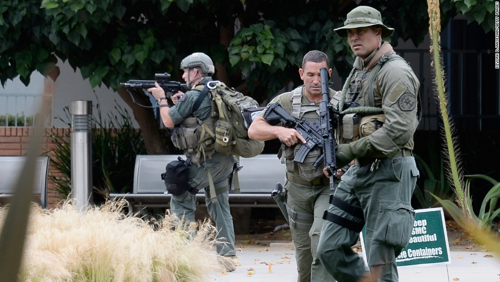 Los Angeles County Sheriff deputies search the grounds.