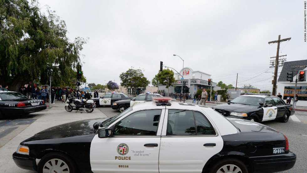 Los Angeles Police Department officers deploy around the campus.