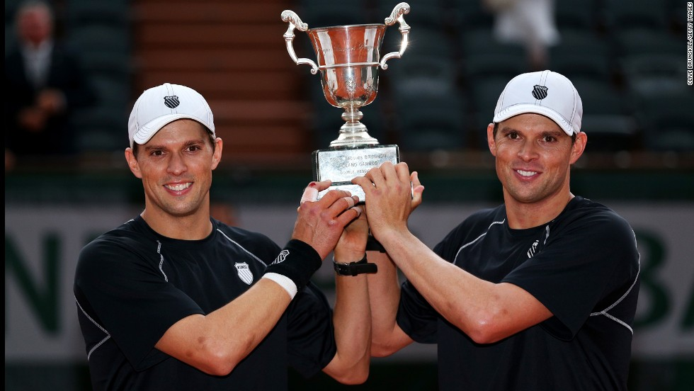 Bob Bryan and Mike Bryan pose with the trophy after winning the men's doubles final against Michael Llorda and Nicolas Mahut of France on June 8. The twins won 6-4, 4-6, 7-6(4).