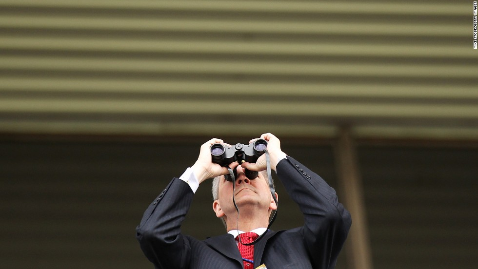 A fan looks through binoculars.