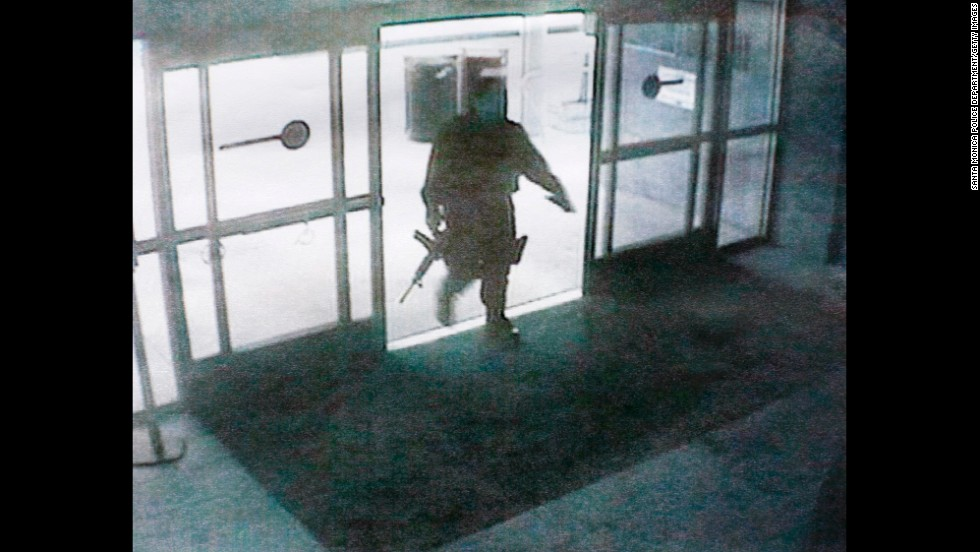 This photo, released by the Santa Monica Police department, shows the gunman entering the Santa Monica College library on June 7.  The gunman's shooting spree began in a home near the college, where two were found dead, and ended when police killed him in the college library. Santa Monica police have identified the suspect as John Zawahri.
