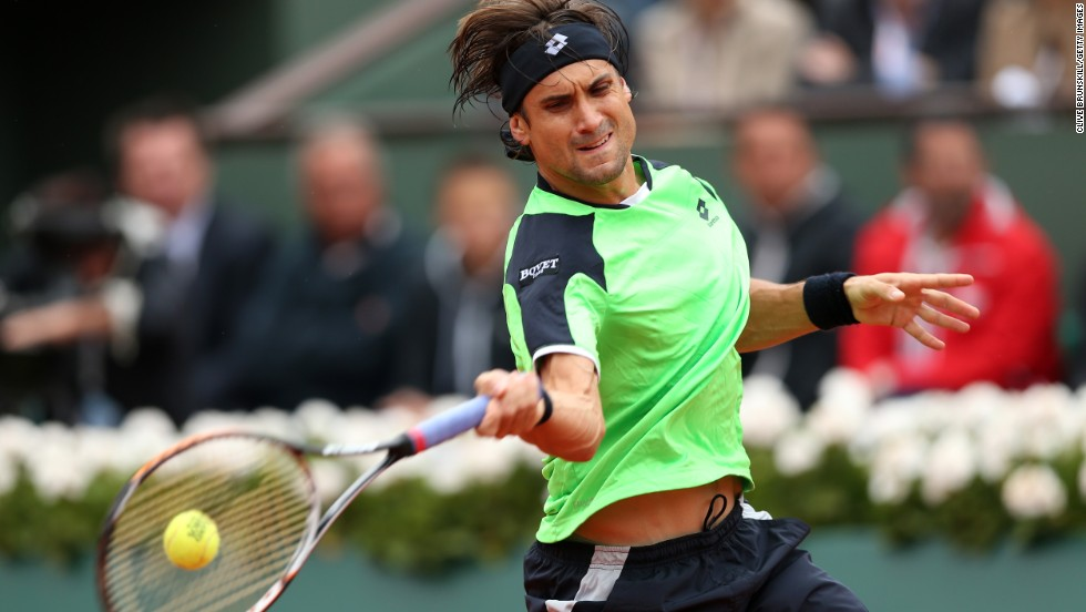 Ferrer plays a forehand to Nadal.
