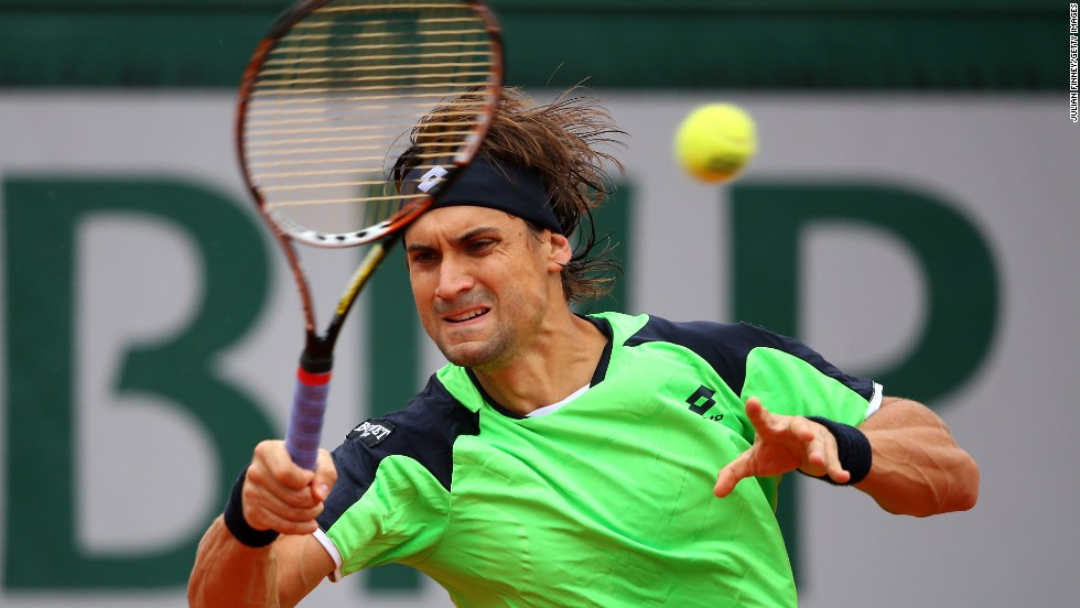 Ferrer plays a forehand against Nadal.