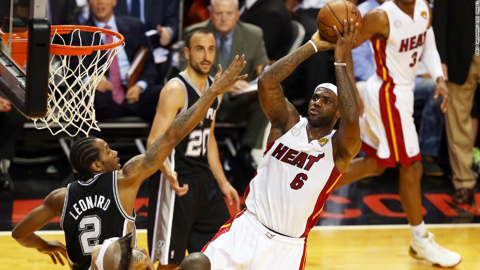 LeBron James of the Miami Heat shoots over Kawhi Leonard of the San Antonio Spurs during Game 2.