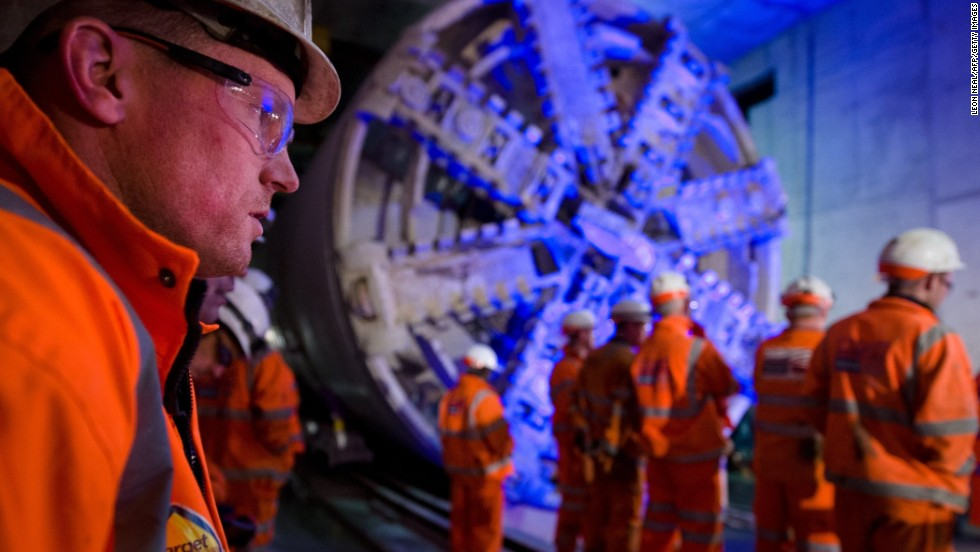 Crossrail construction workers stand near to one of the projects mammoth 1,000-ton tunnel boring machines. The $23 billion development will connect London from east to west, improving access to Heathrow Airport as well as the city's suburban and satellite towns.