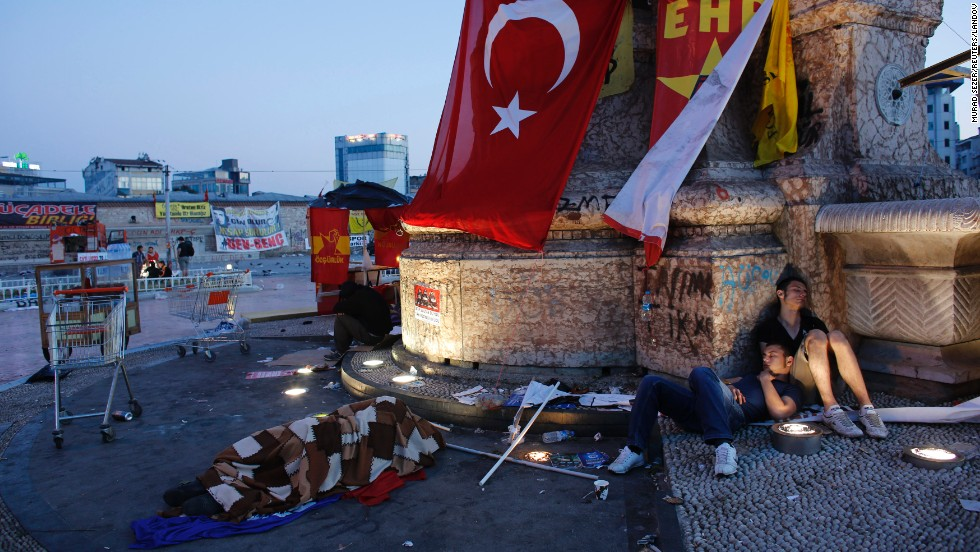 Protesters sleep at Taksim Square in central Istanbul on June 10. Prime Minister Recep Tayyip Erdogan warned protesters who have taken to the streets demanding his resignation that his patience has its limits and compared the unrest with an army attempt six years ago to curb his power.