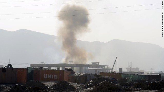 Smoke rises from a building in which insurgents are believed to be holding position near Kabul military airport in Kabul on June 10, 2013, during a clash between insurgents and Afghan security forces. Taliban insurgents claimed responsibility for the continuing attack on Kabul airport on Monday, saying that military facilities had been targeted by gunmen. AFP PHOTO/ Massoud HOSSAINI        (Photo credit should read MASSOUD HOSSAINI/AFP/Getty Images)