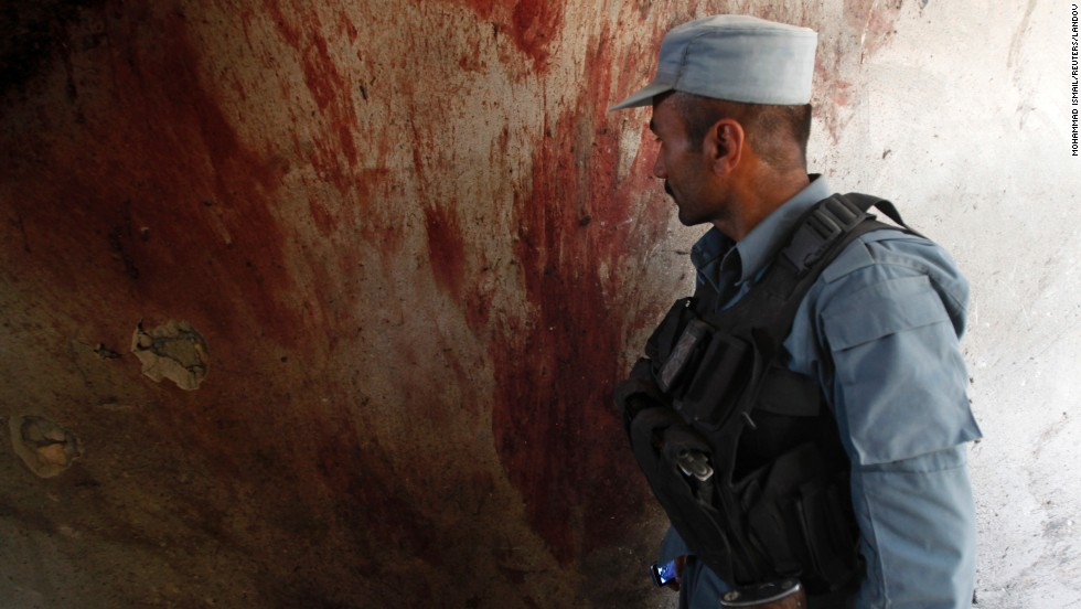 Blood coats the wall of a building after the June 10 attack in Kabul.