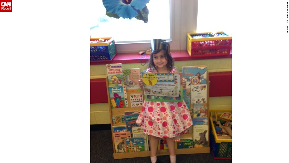 "<a href=""http://ireport.cnn.com/docs/DOC-980248"">Five-year-old Sophie</a> woke up extra excited because she knew she was graduating preschool in northern New Jersey.  ""As soon as my husband and I dropped her off at school, I started to cry,"" mom Kathleen Schmidt said. The graduation ceremony was a low-key affair, after which Schmidt bought her daughter a big coloring book, crayons, candy and sparkly lip gloss. ""I'm not sure about anyone else, but the simple things make my 5-year-old daughter happy."""