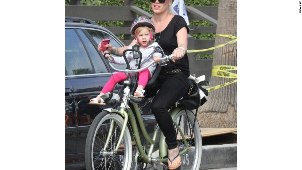 Pink takes her daughter Willow on a bicycle ride in Venice, California.
