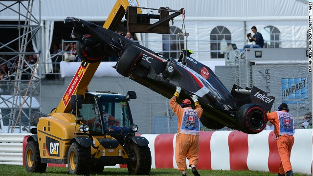 A crane lifts Esteban Gutierrez's Sauber car at the end of Sunday's Canadian Grand Prix at the Circuit Gilles Villeneuve.