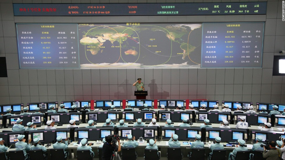 Chinese chief mission commander Zhang Youxia salutes after he announced the successful launch.