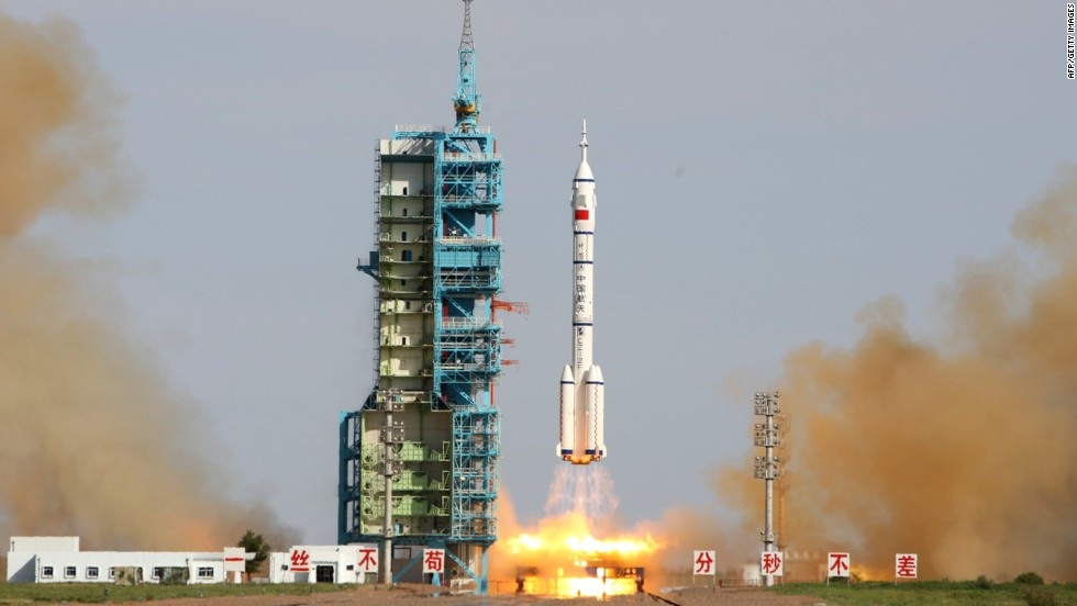 China's Shenzhou 10 rocket blasts off from the Gobi Desert in the city of Jiuquan, in  China's Gansu province, on Tuesday, June 11. The craft is scheduled to dock with the Tiangong-1 space module, where the three crew members will transfer supplies to the space lab, which has been in orbit since September 2011.
