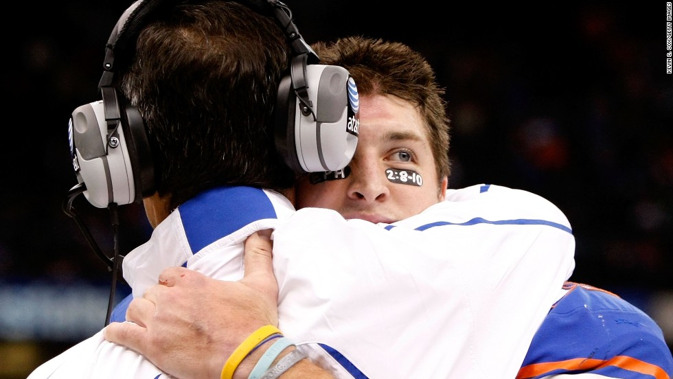 Tebow hugs Florida head coach Urban Meyer during the Sugar Bowl in January 2010. In what was Tebow's last college game, he threw for a career-high 482 yards and ran for another 51 yards. Florida defeated Cincinnati 51-24.