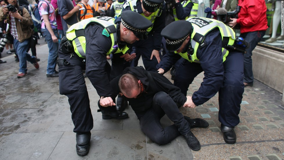 A protester is detained on Oxford Street in London on June 11.