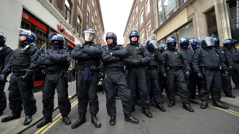 Police stand guard in central London on June 11.