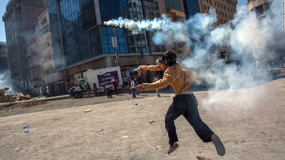 A protester throws a tear gas canister back toward police on June 11.