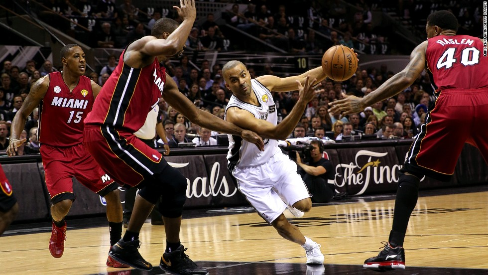 Tony Parker of the San Antonio Spurs drives on Chris Bosh of the Miami Heat in the first quarter.